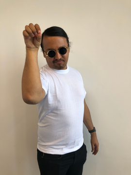 Nextiva employee posing as a popular internet meme.