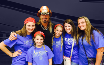 Group of girls posing with Bret Michaels.