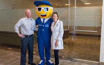Nextiva's mascot posing with St Joseph medical staff.